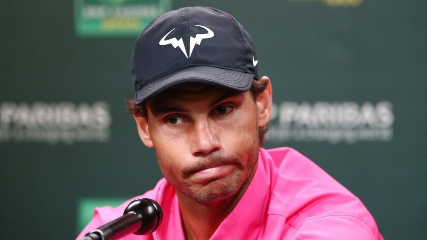 Rafael Nadal addresses the media after he withdrew from the Paribas Open on Saturday because of a knee injury.