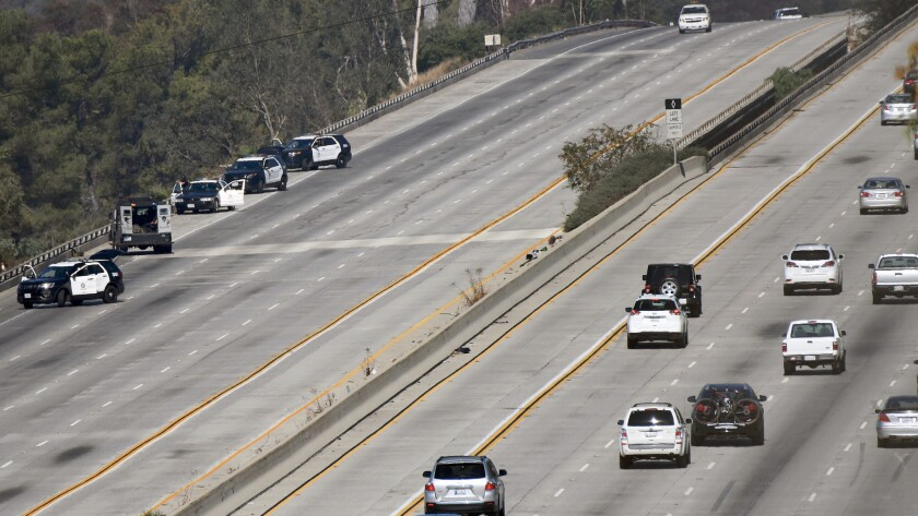 The eastbound 134 Freeway is closed as the LAPD conducts an investigation into the shooting of an LAPD vehicle on the freeway early Sunday morning.