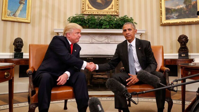 President Obama, right, and President-elect Donald Trump shake hands after their Oval Office meeting Nov. 10.