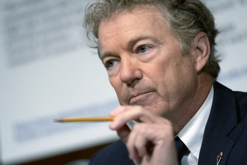 FILE - In this July 20, 2021 file photo, Sen. Rand Paul, R-Ky., speaks during a Senate Health, Education, Labor, and Pensions Committee hearing, on Capitol Hill in Washington. YouTube has suspended Paul for seven days, Wednesday, Aug. 11, after the Kentucky Republican posted a misleading video suggesting face masks don't prevent infection by COVID-19. The video was also removed. (Stefani Reynolds/The New York Times via AP, Pool, File)