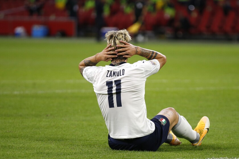Italy's Nicolo Zaniolo reacts after missing a scoring chance during the UEFA Nations League soccer match between The Netherlands and Italy at the Johan Cruijff ArenA in Amsterdam, Netherlands, Monday, Sept. 7, 2020. (AP Photo/Peter Dejong)