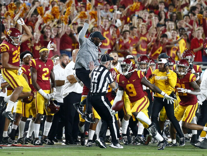 LOS ANGELES, CALIF. - SEP. 7, 2019. USC defensive back Greg Johnson (9) and the Trojans bench celebrate Johnson's interception of a pass by Stanford quarterback Davis Mills in the fourth quarter at the L.A. Memorial Coliseum on Saturday night, Sep. 7, 2019. (Luis Sinco/Los Angeles Times)