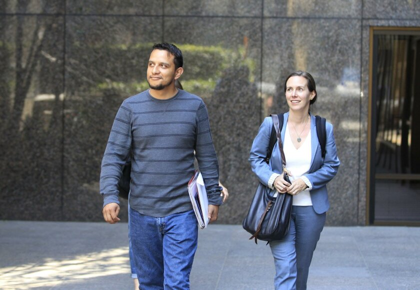 SAN DIEGO, CA April 21, 2016 : | Former United States Marine Daniel Torres (left) and his attorney Jennie Pasquarella (right) leave a naturalization ceremony in downtown on Thursday in San Diego, California.  Torres fought in Iraq, and was living in Tijuana for the last several years trying to beco