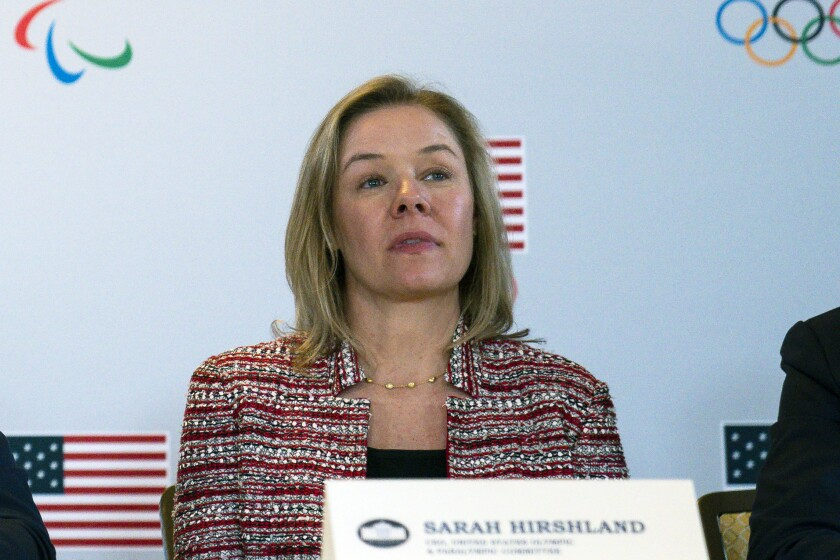 """FILE - In this Feb. 18, 2020, file photo, United States Olympic and Paralympic Committee CEO Sarah Hirshland listens during a briefing with the U.S. Olympic and Paralympic Committee and Los Angeles 2028 organizers in Beverly Hills, Calif. A boycott of next year's Beijing Olympics will not solve any geopolitical issues with China and will only serve to place athletes training for the games under a """"cloud of uncertainty,"""" according to a letter, Hirshland, the head of the U.S. Olympic and Paralympic Committee, wrote to Congress on Thursday, May 13, 2021. Her letter specifically addressed those who believe a boycott of the Winter Games next February would serve as an effective diplomatic tool to protest China's alleged abuses toward Uyghurs, Tibetans and Hong Kong residents. (AP Photo/Evan Vucci, File)"""