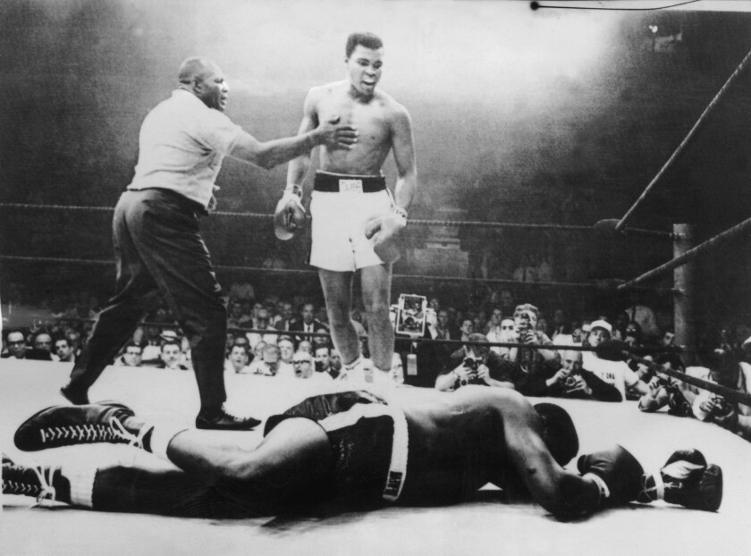 A picture taken May 26, 1965, in Lewiston, Maine, during the world heavyweight boxing championship, which Muhammad Ali won against Sonny Liston after a one-minute fight, with Joe Walcott as a referee.