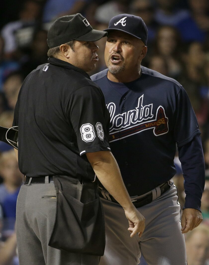 Atlanta Braves manager Fredi Gonzalez, right, argues with home plate umpire Doug Eddings during the third inning of a baseball game against the Chicago Cubs, Thursday, Aug. 20, 2015, in Chicago. Gonzalez ejected by Eddings. (AP Photo/Nam Y. Huh)