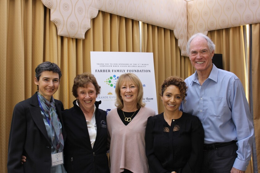 Sam and Vivian Hardage (center and far right) with researchers (left to right) Dr. Maria Vittoria Schiaffino (San Raffaele Scientific Institute, Italy) and Dr. Debora Farber and Dr. Alejandra Young (both of UCLA Stein Eye Institute).