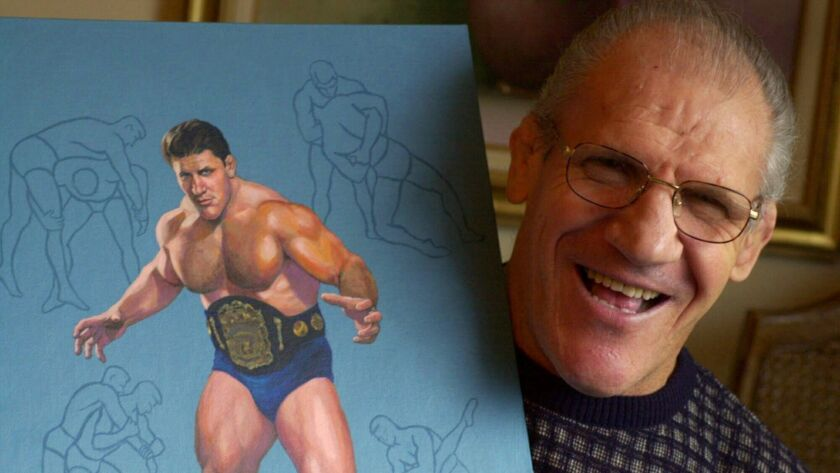 Bruno Sammartino poses in 2000 with a painting of him in his pro wrestling prime in 1965.