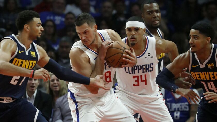LOS ANGELES, CALIF. - OCT. 17, 2018. Clippers forward Danilo Galinari pulls down a rebound against t