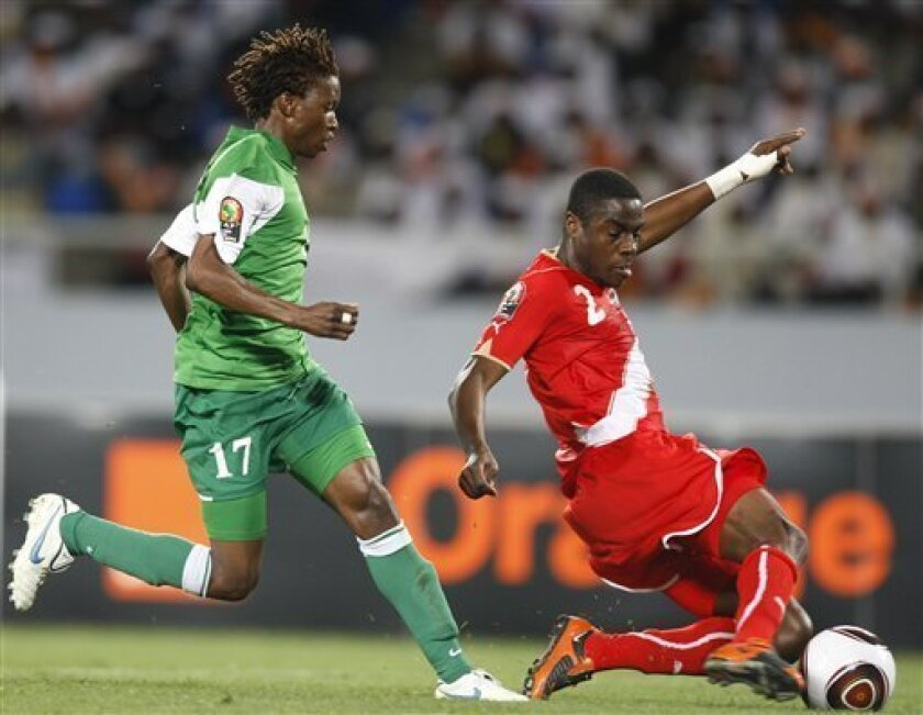 Tunisia's Khaled Souissi, right, stops an attack by Zambia's Rainford Kalaba in their African Cup of Nations Group D soccer match at Tundavala Stadium in Lubango, Angola Wednesday, Jan. 13, 2010. (AP Photo/Rebecca Blackwell)