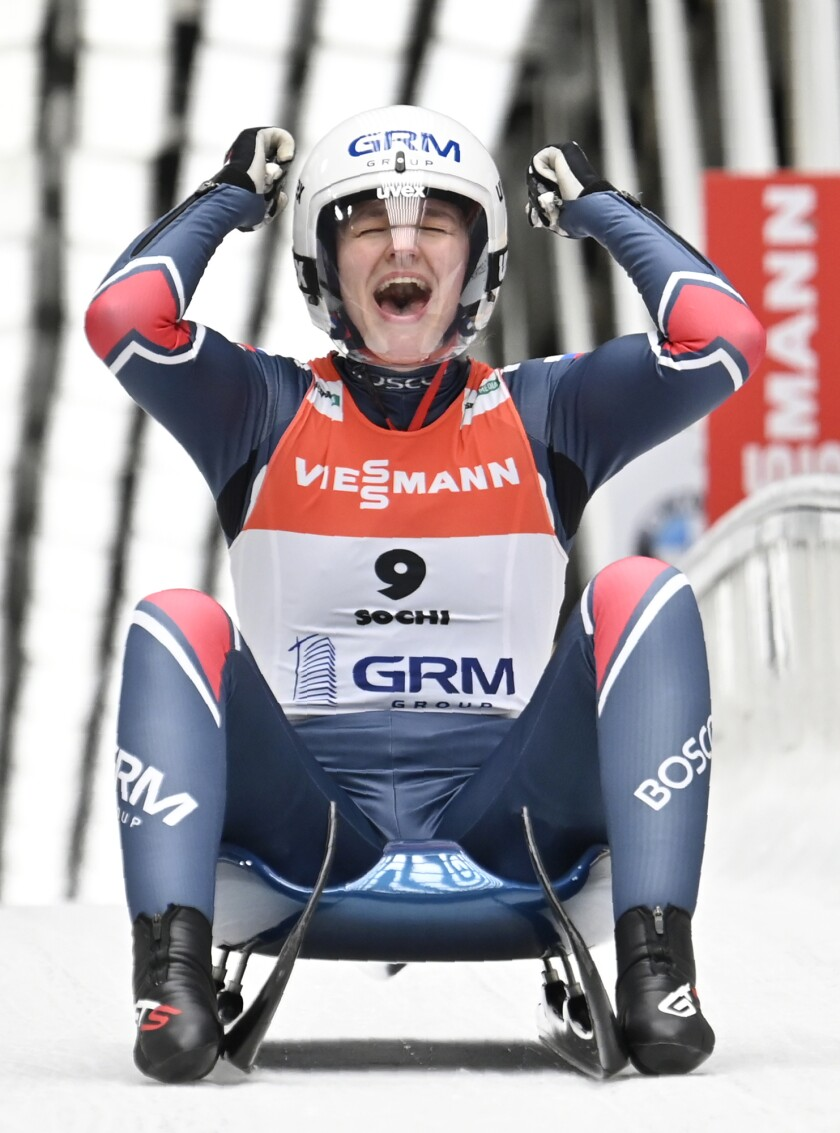 Gold medallist Ekaterina Katnikova, of Russia, celebrates in the finish area during the women's singles race at the Luge World Cup event in Krasnaya Polyana in Sochi, Russia, Saturday, Feb. 15, 2020. (AP Photo/Artur Lebedev)