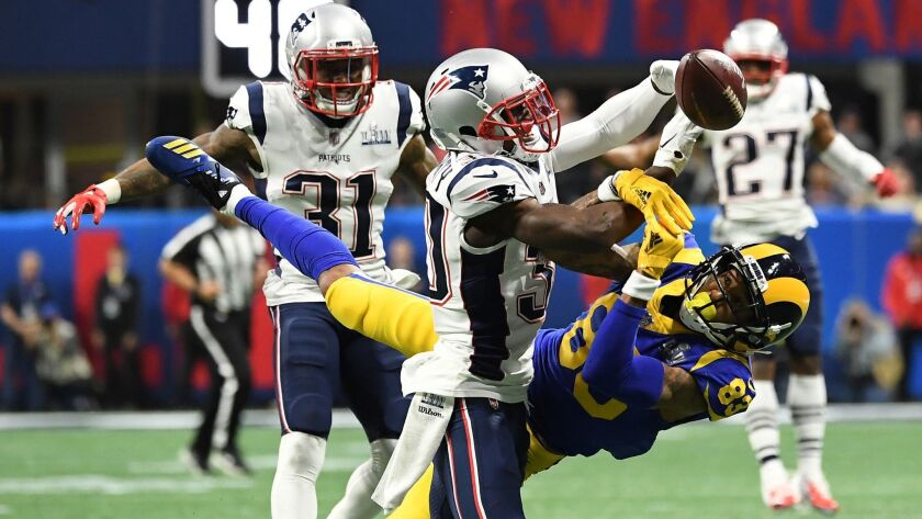 ATLANTA, GEORGIA, FEBRUARY 3, 2019 - Patriots' Jason McCourty, left, breaks up a pass intended for L