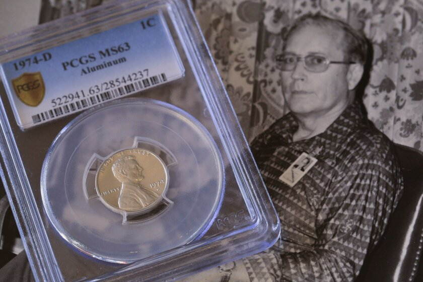 This rare 1974-D penny made from aluminum was originally owned by Harry Lawrence (man in photo) until his death and later by his son Randy Lawrence who inherited his father's coin collection. The rare coin was returned back to the U.S. Treasury Department.