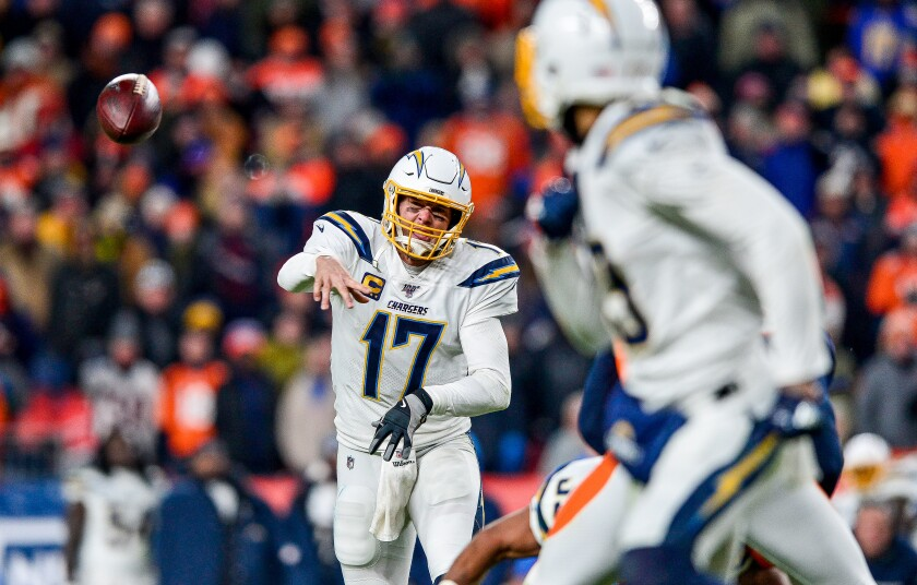 Chargers quarterback Philip Rivers completes a pass to Keenan Allen.