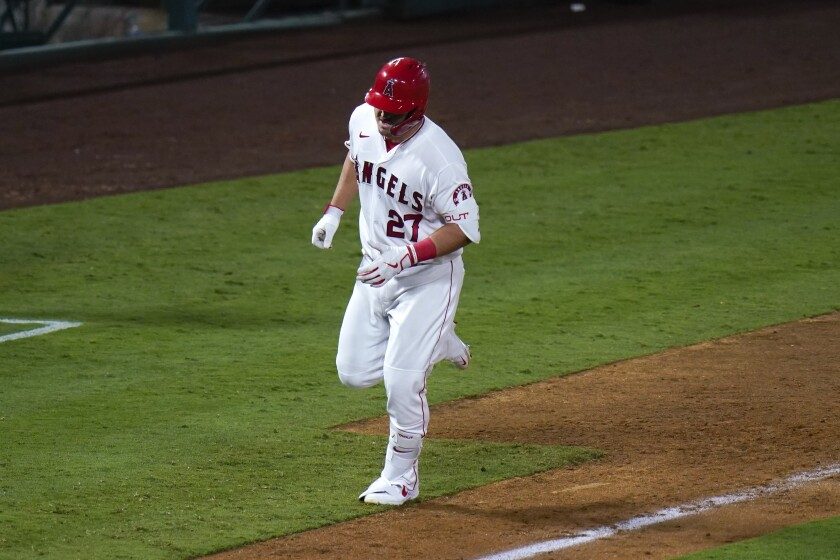 Los Angeles Angels' Mike Trout rounds the bases after hitting a home run during the eighth inning of a baseball game against the Oakland Athletics, Monday, Aug. 10, 2020, in Anaheim, Calif. (AP Photo/Jae C. Hong)