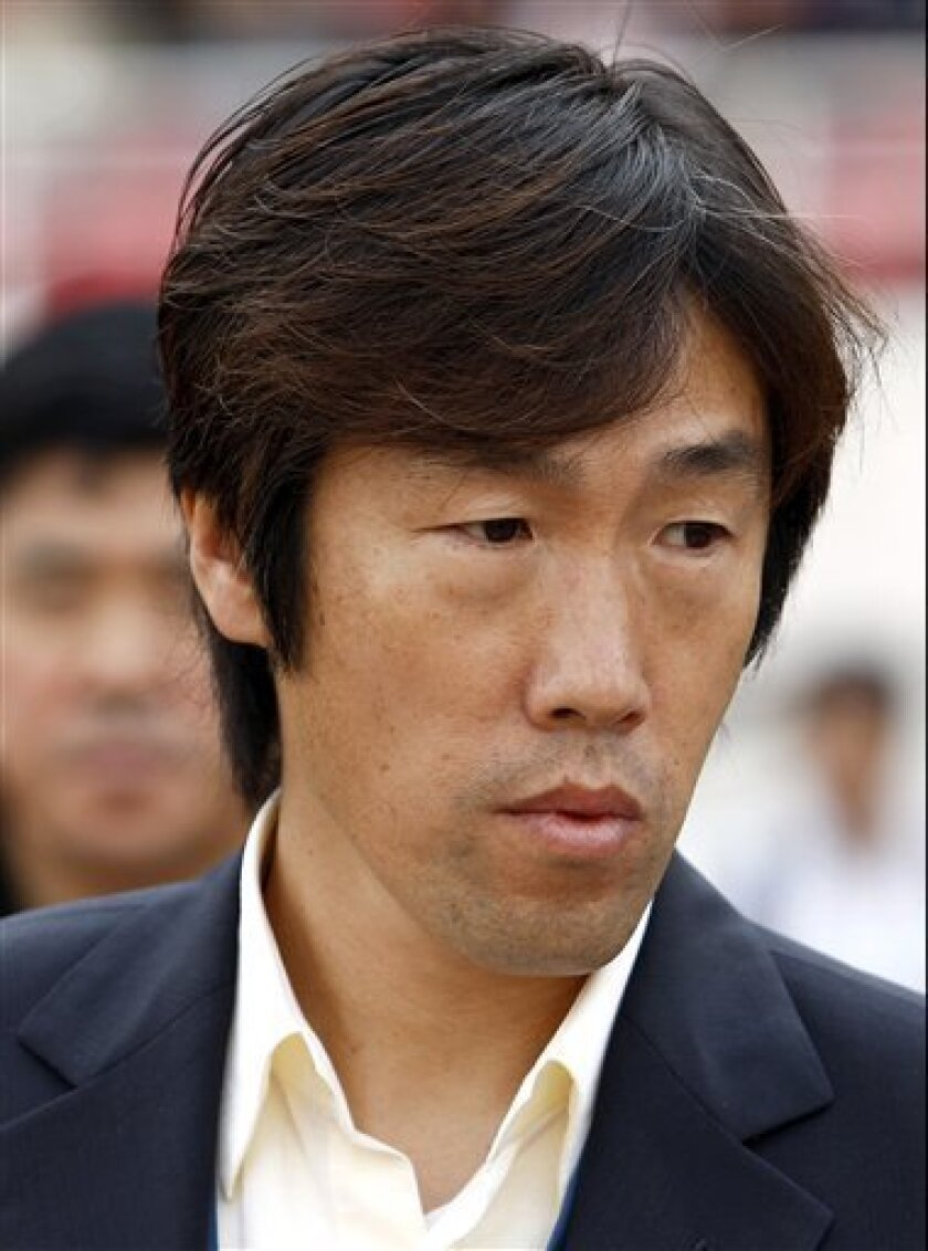 In this photo taken May 22, 2008, China's new national football team coach Gao Hongbo is seen during a match in Changchun, in northeast China's Jilin province. China's new national football coach Gao has set qualification for the 2014 World Cup as a target in his quest to revitalize the beleaguered team. (AP Photo)
