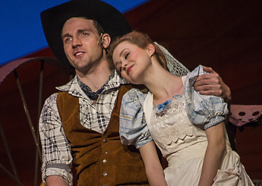 """Bryant Martin and Madison Claire Parks as Curly and Laurey in """"Oklahoma!"""" at the Carpenter Center."""