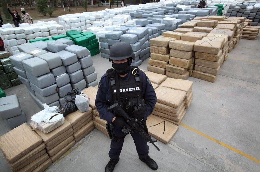 More than 100 tons of marijuana is displayed to the media at the Morelos Military base in Tijuana.
