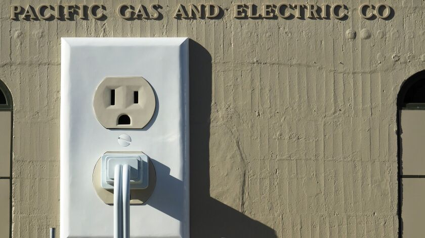 """An art installation titled """"Outlet-plug-cord"""" (2015) adorns the side of a Pacific Gas & Electric substation in Petaluma, Calif., in July 2015."""