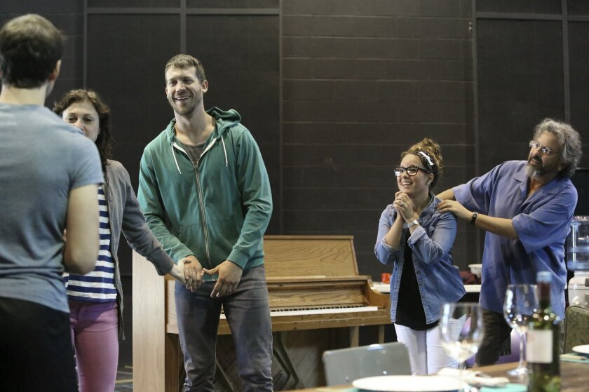 Thomas Dellamonica, Meghan O'Neill, Russell Harvard, Dina Thomas, and Jeff Still (left to right), run through a rehearsal for the upcoming play Tribes at the La Jolla Playhouse on Friday. The play opens June 25 and runs through July 21 at the La Jolla Playhouse.
