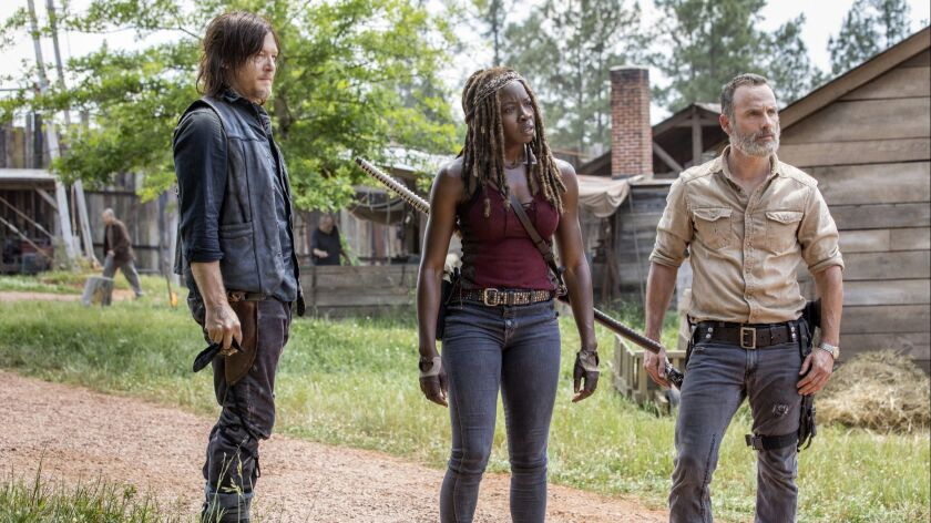 Norman Reedus as Daryl Dixon, Andrew Lincoln as Rick Grimes, Danai Gurira as Michonne- The Walking