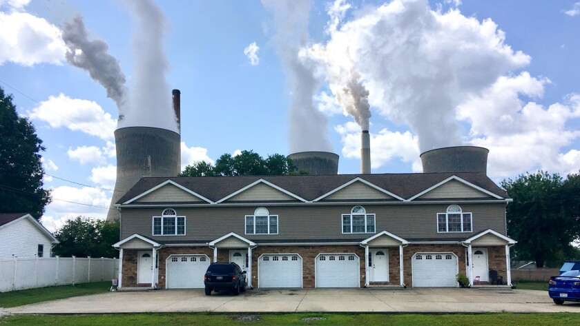 American Electric Power's John Amos coal-fired plant in Winfield, W.Va., is seen from an apartment complex in the town of Poca across the Kanawha River on Aug. 23.