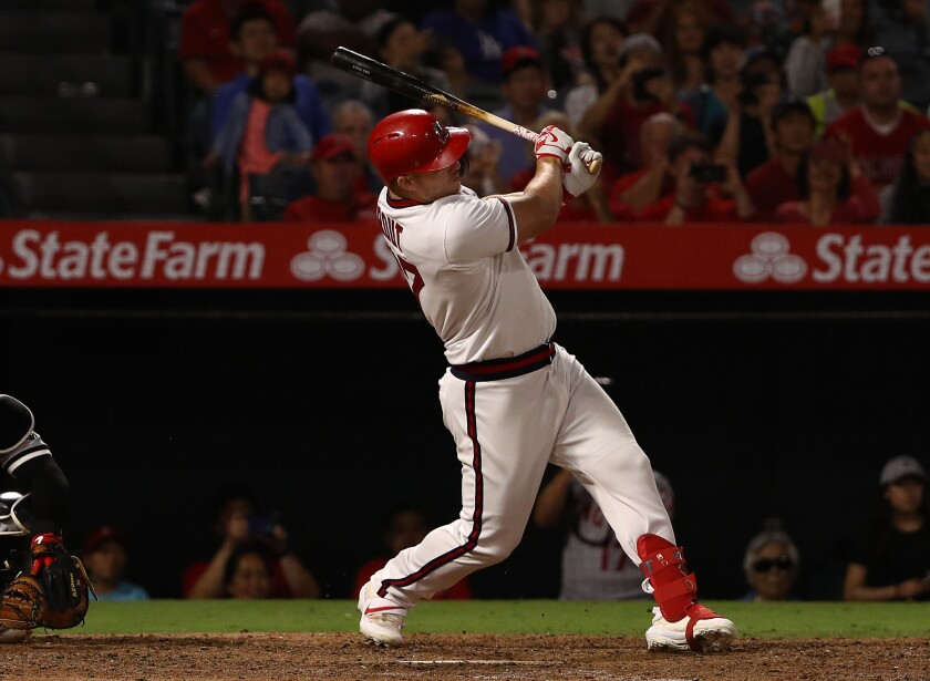 The Angels' Mike Trout connects for a two-run single against the White Sox on Aug. 17, 2019.