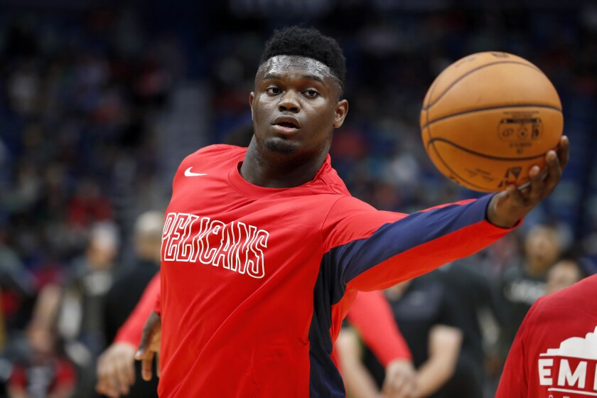 New Orleans Pelicans forward Zion Williamson warms up before a preseason game against the Utah Jazz on Oct. 11.