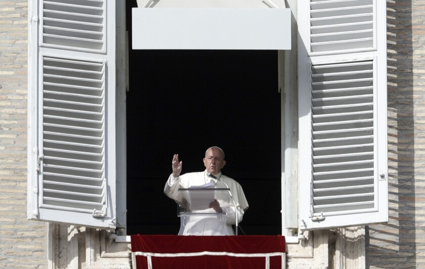 Pope Francis delivers his message during his Angelus prayer from his studio window overlooking St. Peter's Square, at the Vatican, Sunday, Nov. 10, 2019. (AP Photo/Gregorio Borgia)