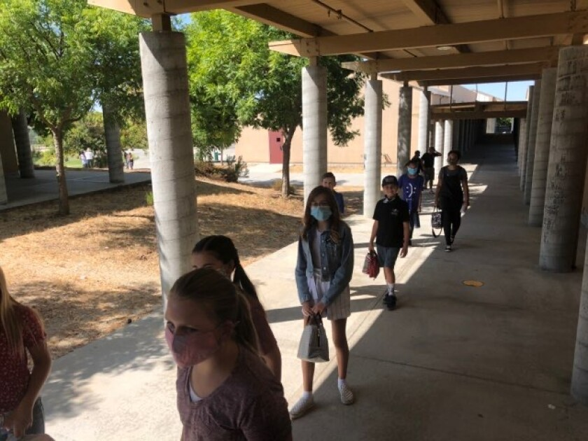 Students in line at Joan McQueen Middle School in Alpine Union, which opened Sept. 21.