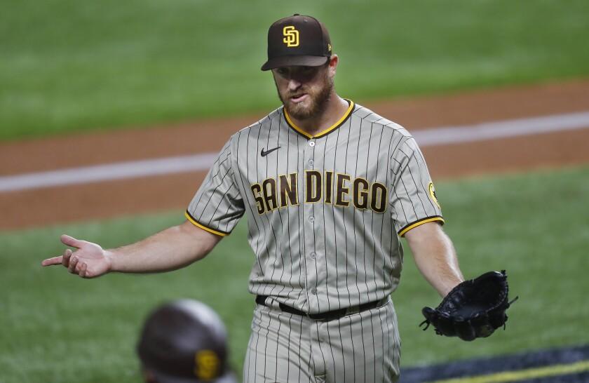 Austin Adams of the San Diego Padres walks off the