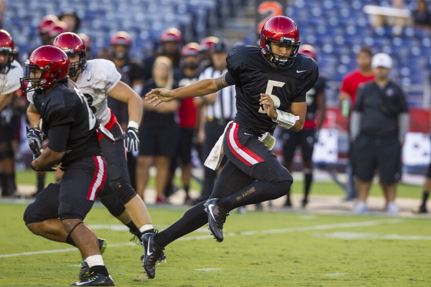 SDSU quarterback Mark Salazar hands off in the third quarter.