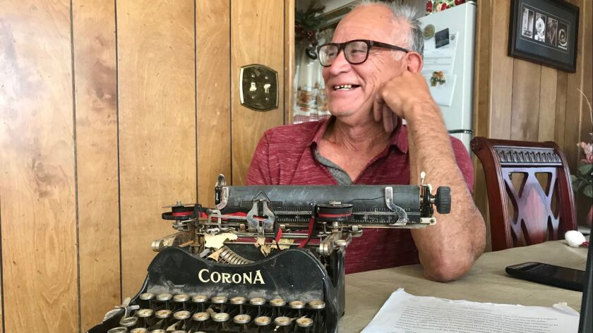 63-year-old Jerry Valencia shows off an old Corona typewriter at his home. He is a junior at Cal St