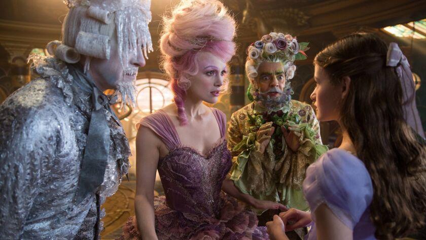 "Richard E. Grant as Shiver, Keira Knightley as the Sugar Plum Fairy, Eugenio Derbez as Hawthorne and Mackenzie Foy as Clara in Disney's ""The Nutcracker and Four Realms."""