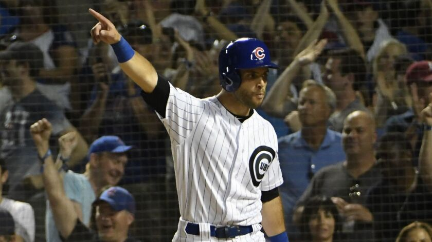 Tommy La Stella reacts after scoring against the San Francisco Giants.