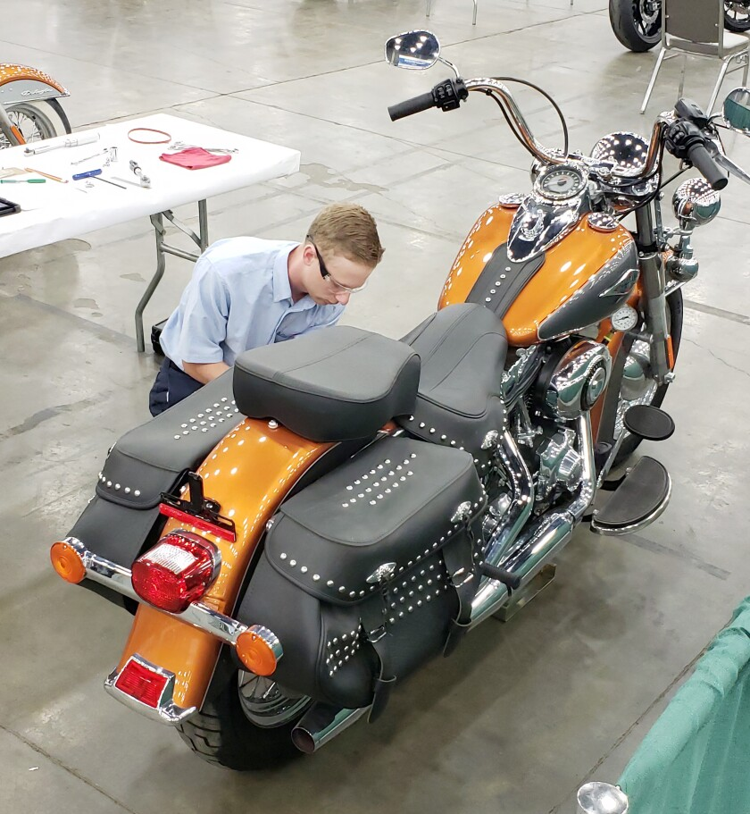 Copy - Seth Levy Works on a Motorcycle.jpg