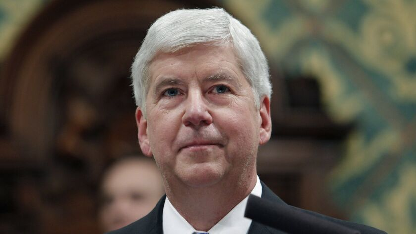 In this Jan. 23, 2018, former Michigan Gov. Rick Snyder delivers his State of the State address at t