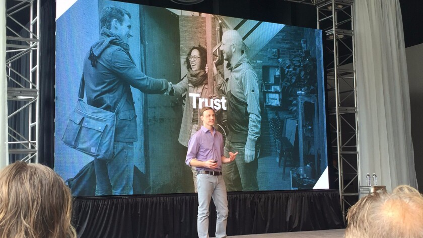 Airbnb's vice president of engineering, Mike Curtis, addresses the audience at the company's annual OpenAir conference.