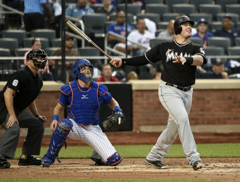 Miami Marlins' Justin Bour hits a three-run home run off of New York Mets starting pitcher Matt Harvey as Kevin Plawecki catches for the Mets in the fourth inning of a baseball game at Citi Field on Friday, May 29, 2015, in New York. (AP Photo/Kathy Kmonicek)
