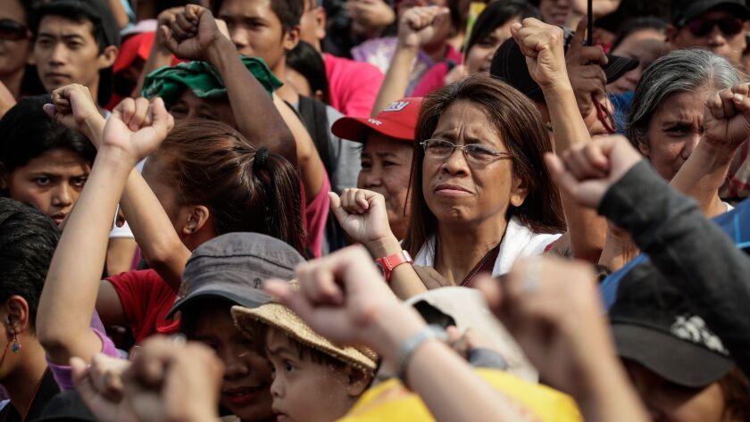 Manila: Women attend a protest rally marking International Women's Day.