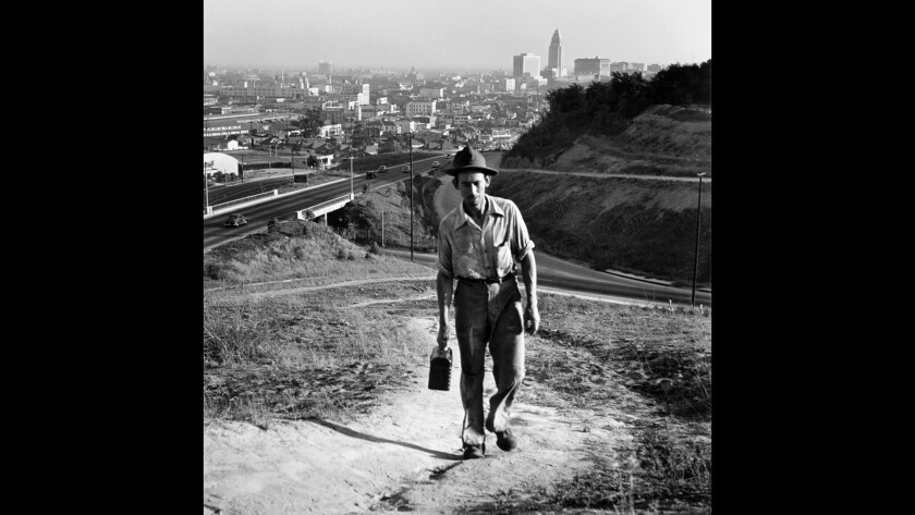 A workman returns to his home in the La Loma neighborhood in Chavez Ravine in Los Angeles in 1949.