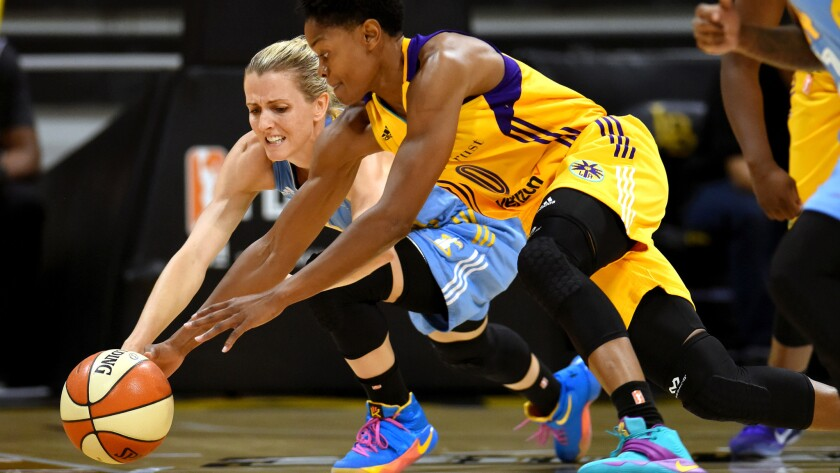 Sparks guard Alana Beard (0) tries to beat Sky guard Allie Quigley to a loose ball during the first half of Game 1.
