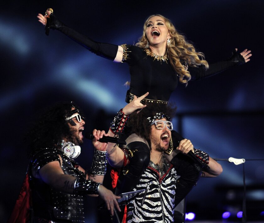 Singer Madonna, top, performs with LMFAO during the 2012 Super Bowl in Indianapolis. She's celebrating the arrest of a man who allegedly hacked her computer, leaked unreleased music.