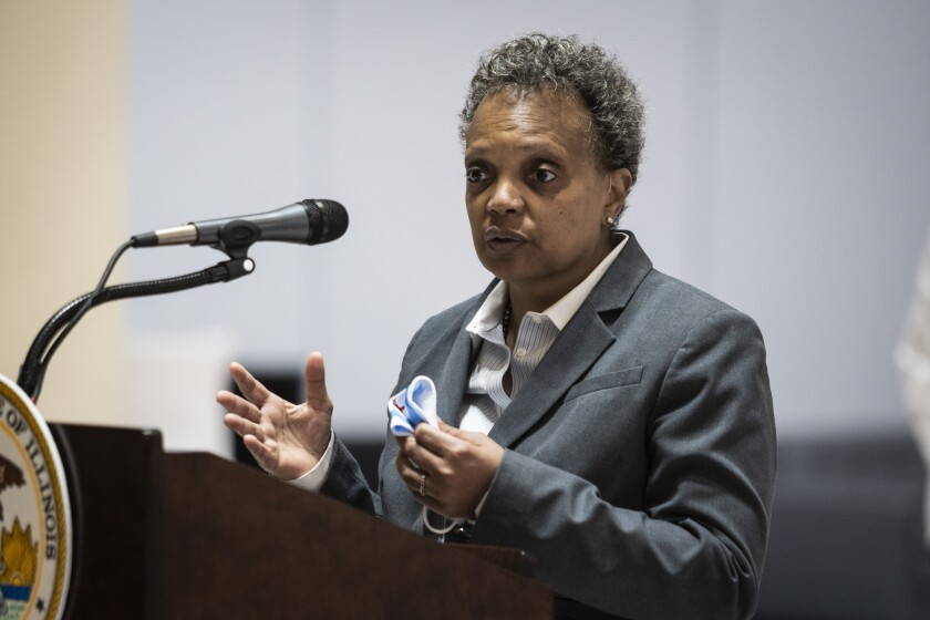 FILE - In this Monday, May 10, 2021, file photo, Mayor Lori Lightfoot speaks during a news conference in Chicago. After decades of organizing by parents, activists and unions, Chicago is on the verge of having a fully-elected school board for the first time in its history. Among the most vocal critics is first-term Mayor Lightfoot, who would lose control of a board that's been her rubber stamp, if she remains in office. (Ashlee Rezin Garcia/Chicago Sun-Times via AP)