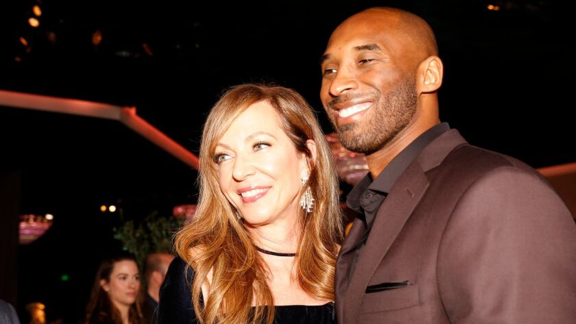 """Allison Janney, left, nominated for supporting actress, with Kobe Bryant, nominated for his animated short film """"Dear Basketball,"""" during the nominees luncheon on Feb. 5."""
