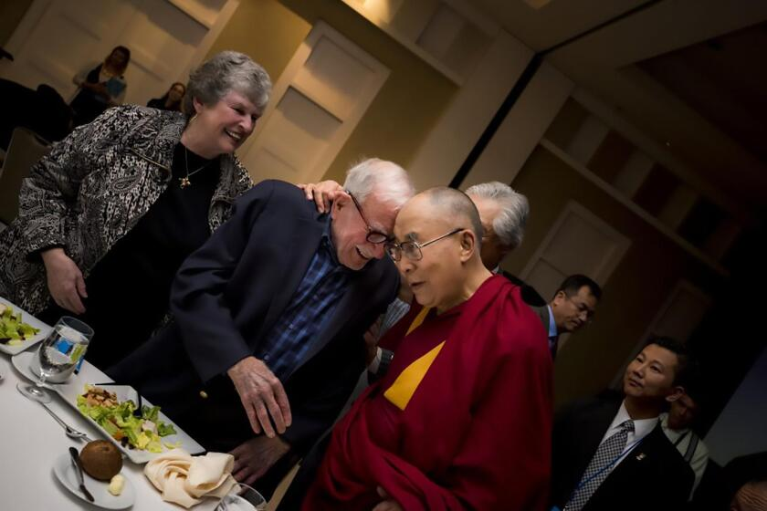 Walter Munk with Mary Coakley-Munk, his wife since 2011, and the Dalai Lama, who was UC San Diego's 2017 commencement speaker.