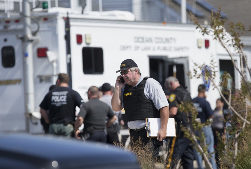 Police gather at a command center in Seaside Park, N.J. on Saturday, Sept. 17.