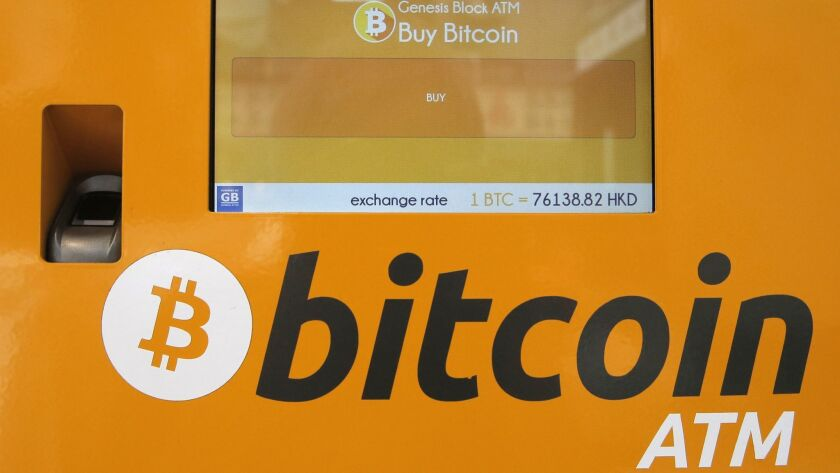A Bitcoin ATM is seen in Hong Kong, Friday, May 11, 2018. Bitcoin is the world's most popular virtua
