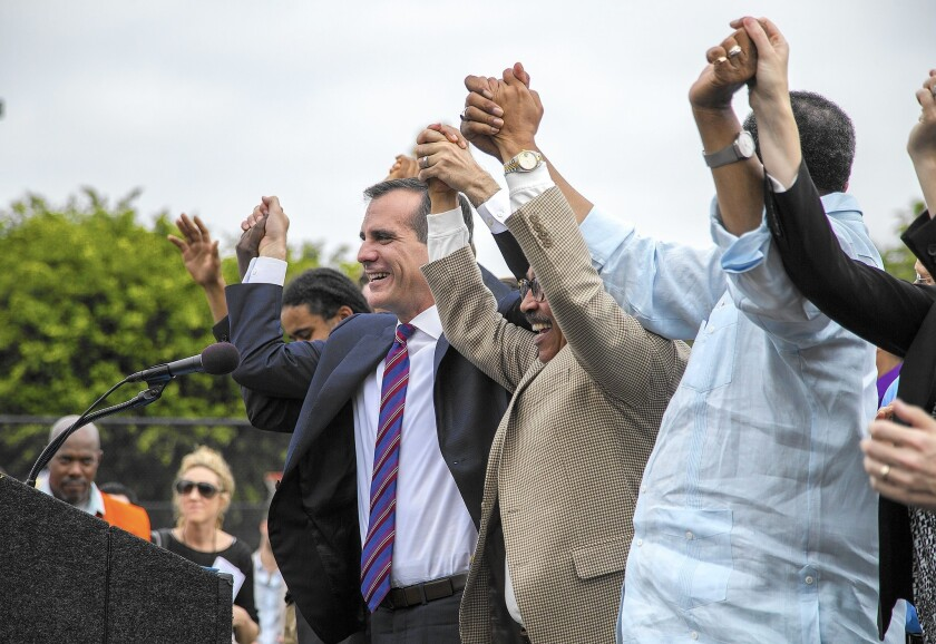 Garcetti signs measure raising L.A.'s minimum wage