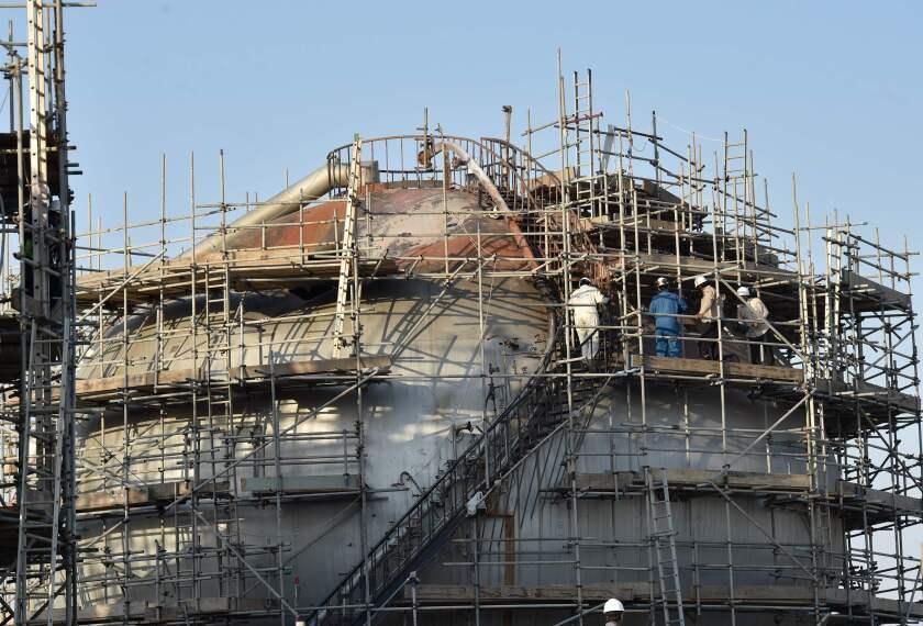 Workers repair Saudi oil processing plant